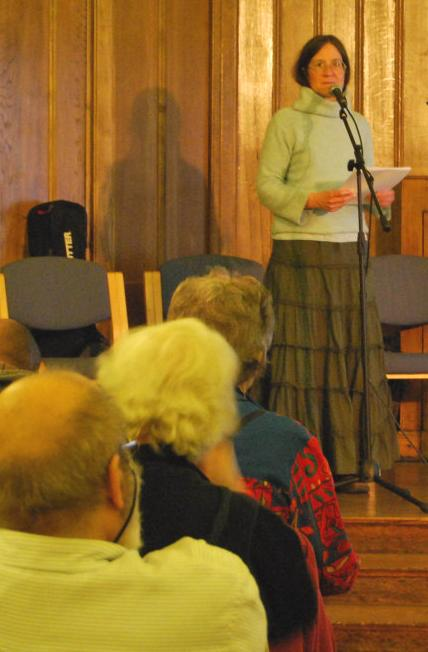 A spellbound audience listens to Sarah